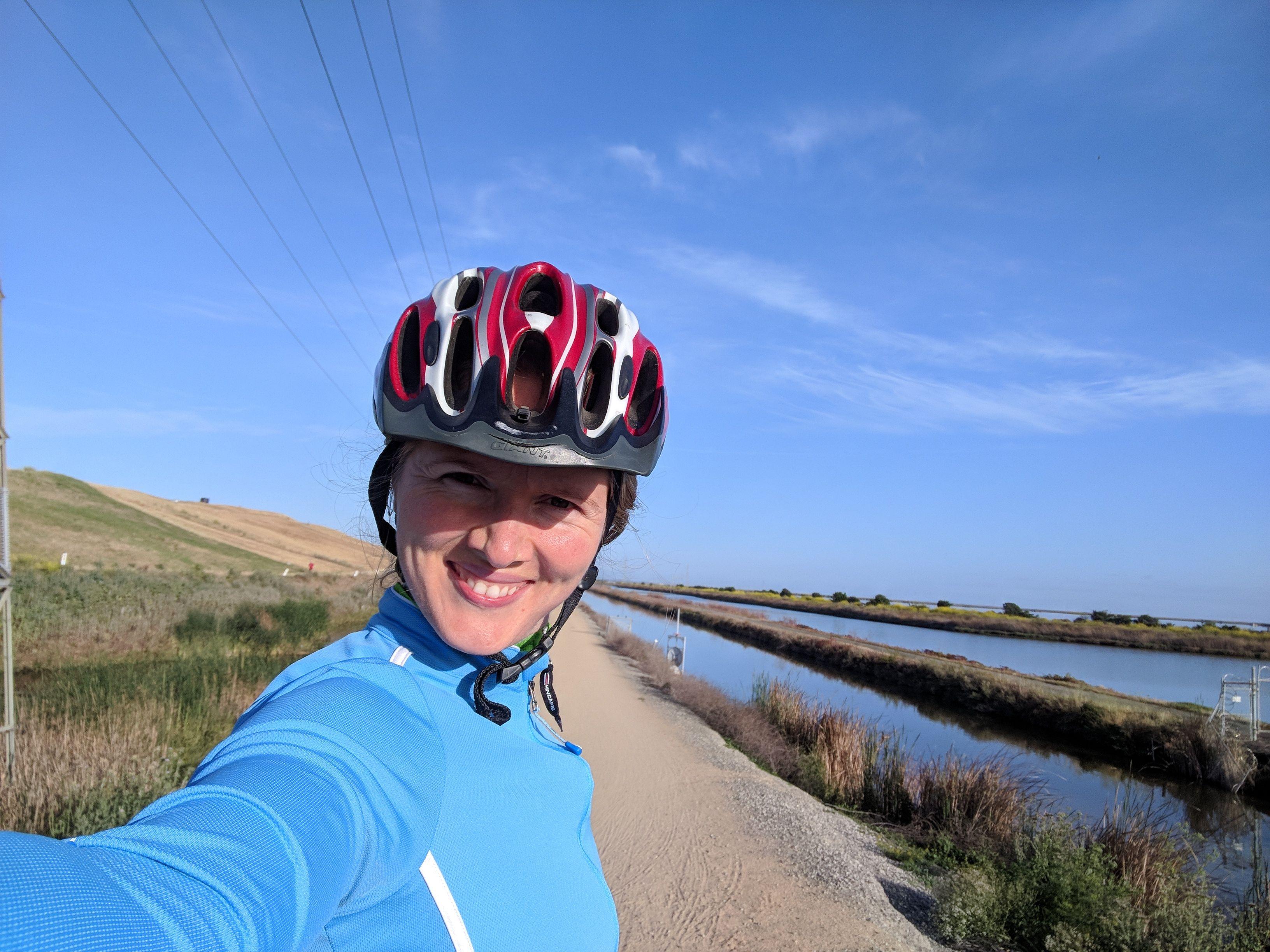 Diana biking along the San Francisco Bay