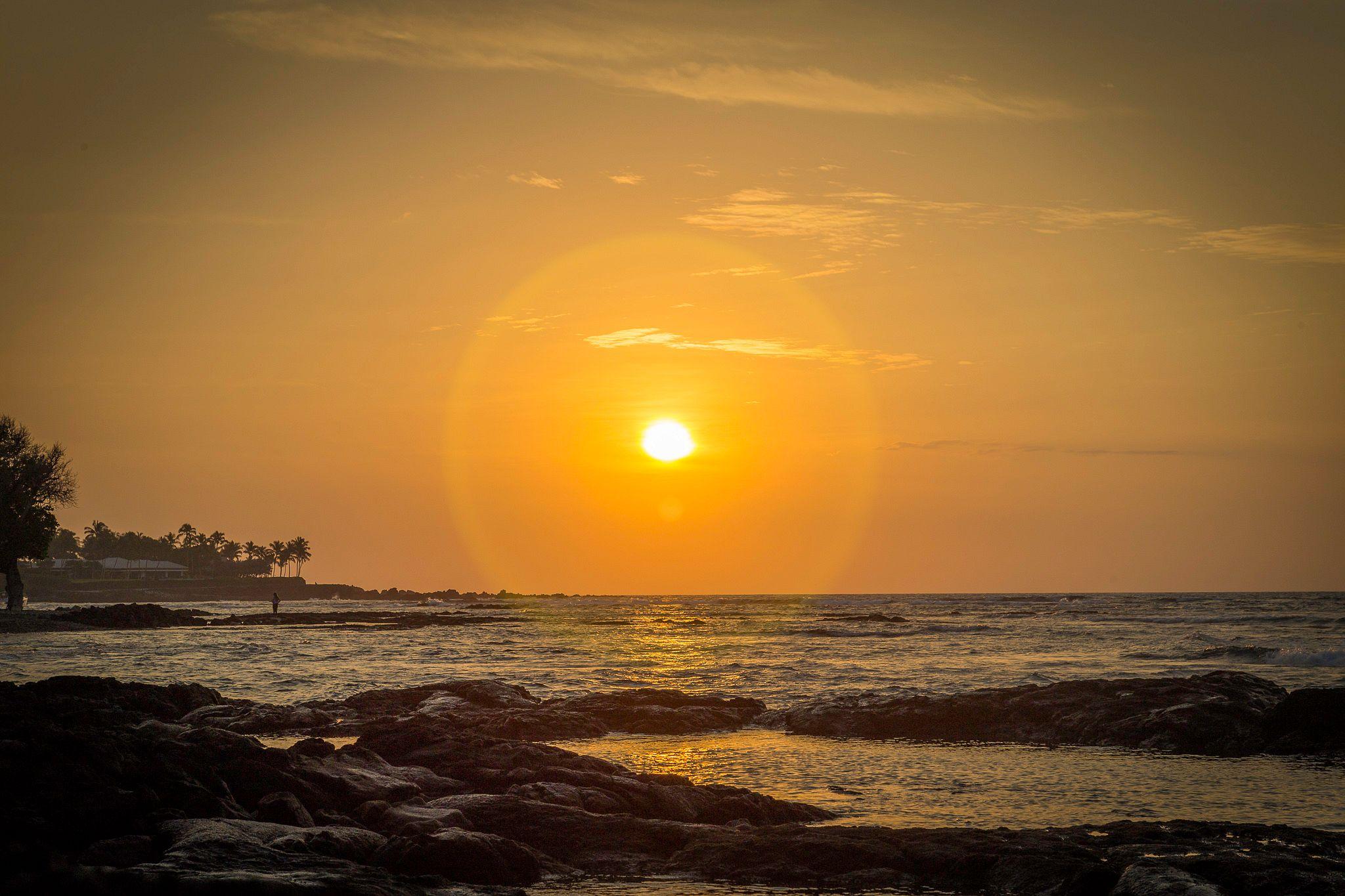 Hawaii sunset in yellow and orange tones.