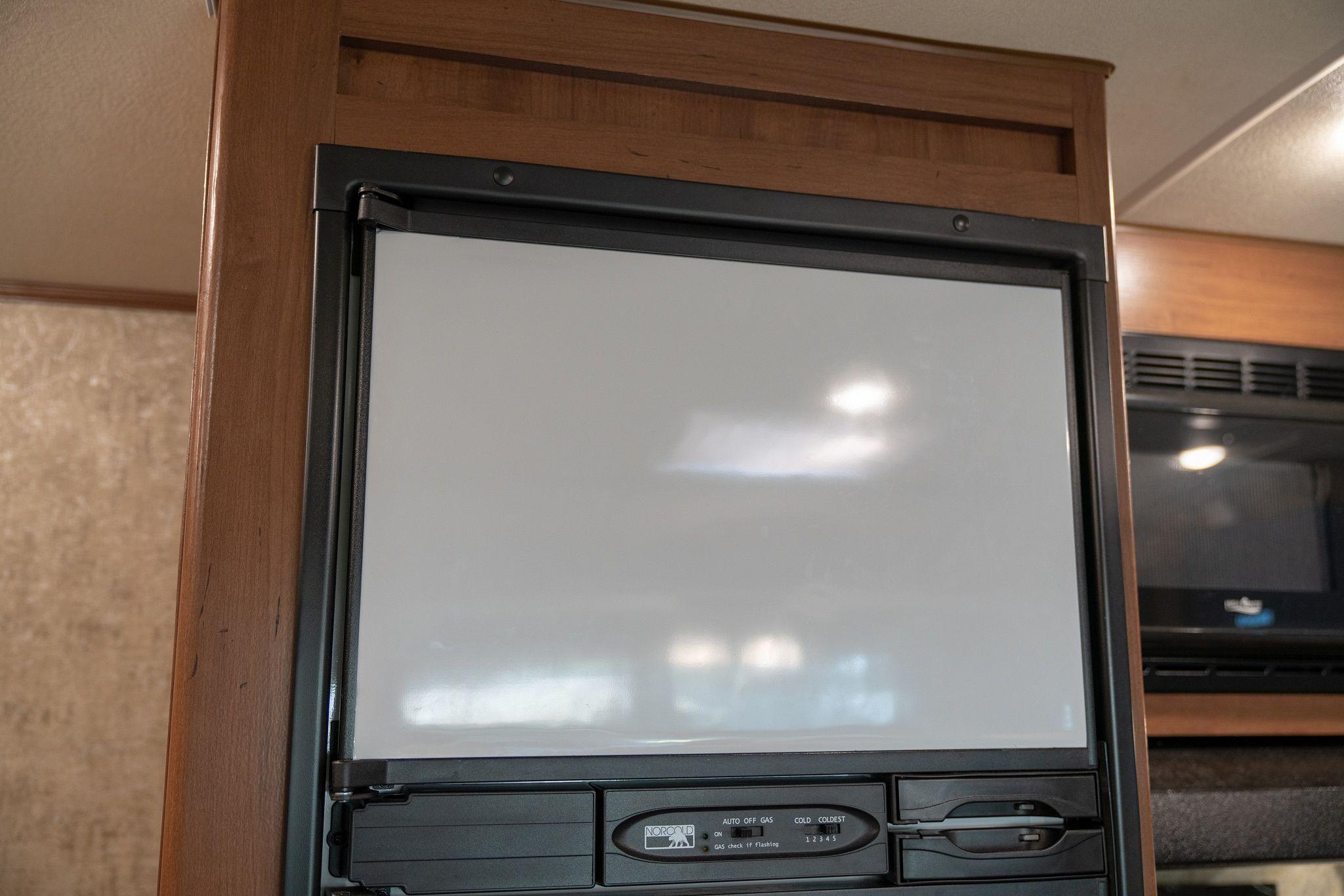 Magnetic dry-erase RV freezer door