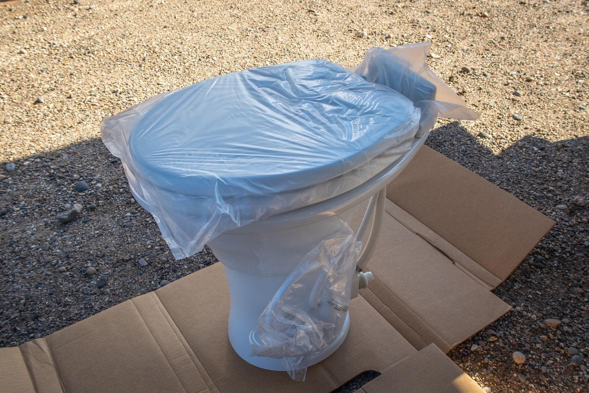 Inspecting RV Toilet